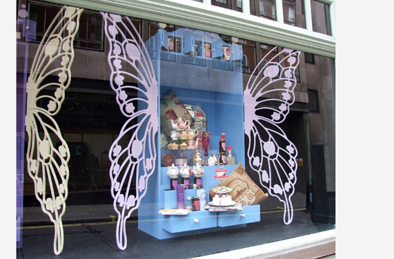 Butterfly cut outs and cabinets for multiple windows.